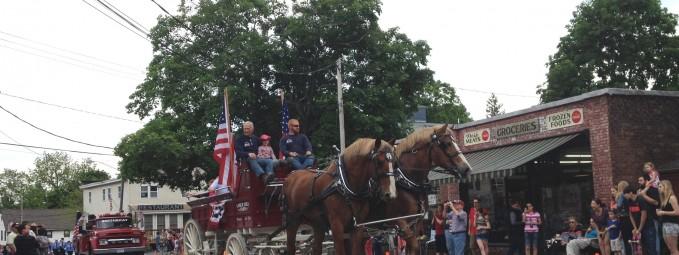 Horse drawn wagon on Main Street at 2014 Memorial Day Parade